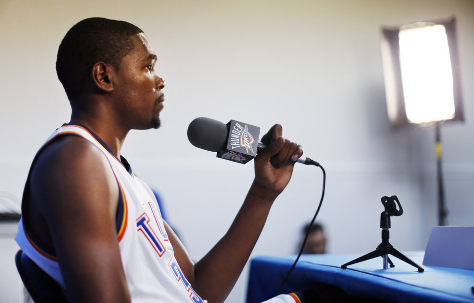 Photo - Kevin Durant listens to a question at a press conference during media day for the Oklahoma City Thunder NBA basketball team at the Thunder Events Center in Oklahoma City, Monday, Oct. 1, 2012.  Photo by Nate Billings, The Oklahoman