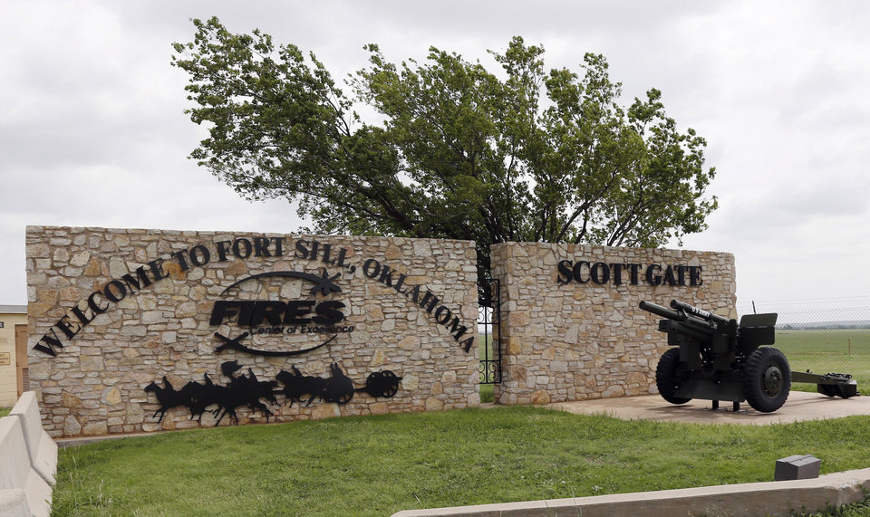 Photo -  This June 17, 2014 file photo shows an entrance to Fort Sill near Lawton, Okla. The federal government has chosen the military base in Oklahoma as the location for a new temporary shelter to house migrant children and is considering a customs port in southern New Mexico as another option as existing shelters are overwhelmed. [AP photo]