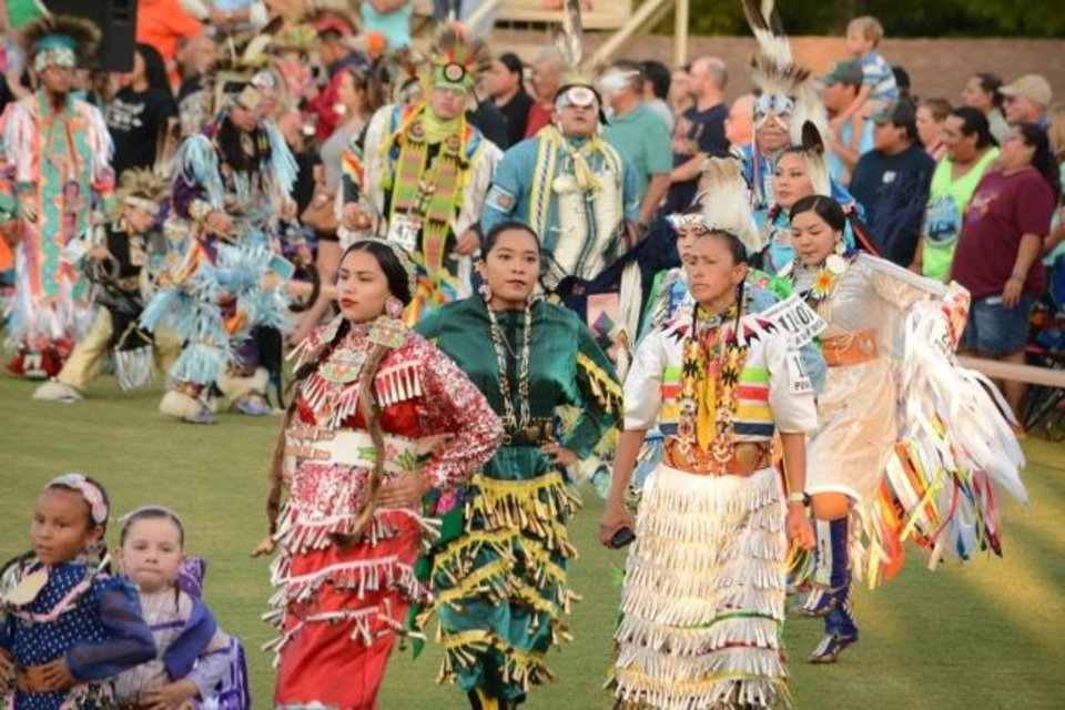 Photo -  Dancers enter the Cherokee Cultural Grounds arena during the grand entry of the 2018 Cherokee National Holiday Intertribal Powwow. [Photo provided]