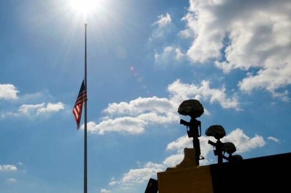Photo - This photo, from the U.S. Department of Defense, shows an American flag at Fort Hood resting at half-staff on Nov. 10, 2009, during a memorial ceremony in honor of the victims of the Nov. 5, 2009 shooting rampage.