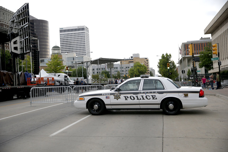 Photo - Police block a staging area ahead of President Donald Trump's Saturday campaign rally, Friday, June 19, 2020, in downtown Tulsa. [Sarah Phipps/The Oklahoman]