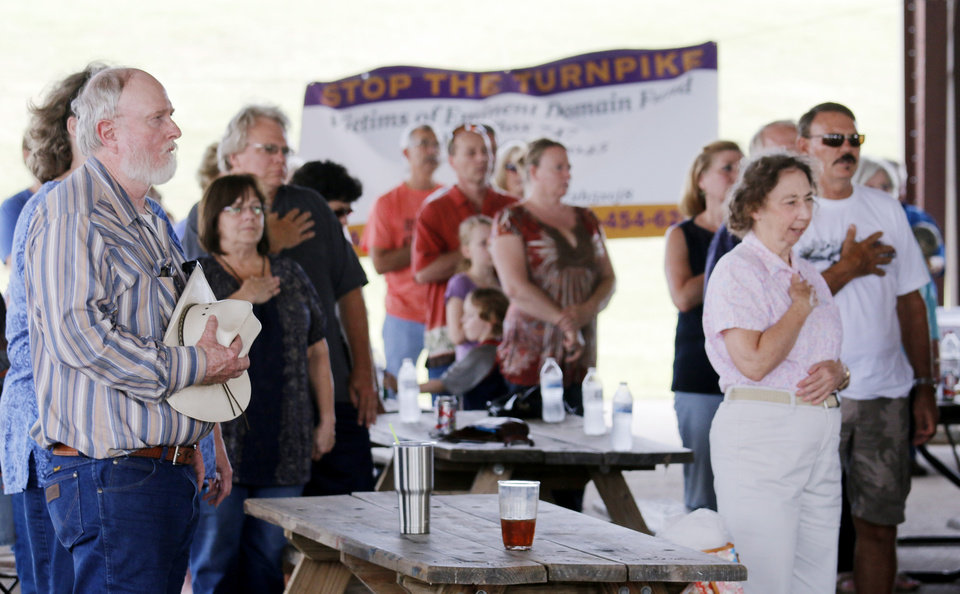 Photo - The crowd sings along during the National Anthem during the Victimsofiminentdomain.com rally at Choctaw Creek Park, in Choctaw, against the eastern Oklahoma county turnpike leg that the Oklahoma Turnpike Authority has proposed building Friday, August 12, 2016. Photo by Doug Hoke, The Oklahoman