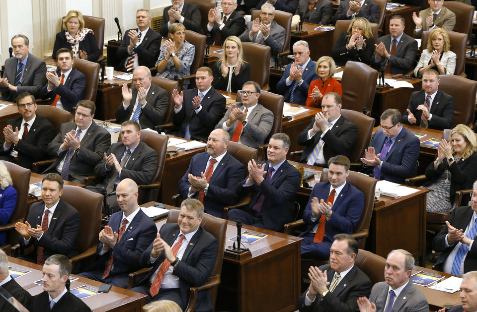 Photo - Legislators applaud during Gov. Kevin Stitt's address. Gov. Stitt said teachers deserve another pay raise and asked state lawmaker for the money to fund it in his first State-of-the-State address, which he also used to outline his vision for an economy-focused administration that will produce an efficient and adaptive state government. He outlined his plans moving forward in his first term as governor while speaking to lawmakers on Monday, Feb. 4, 2019, as the 57th Legislature officially began.  Photo by Jim Beckel, The Oklahoman.