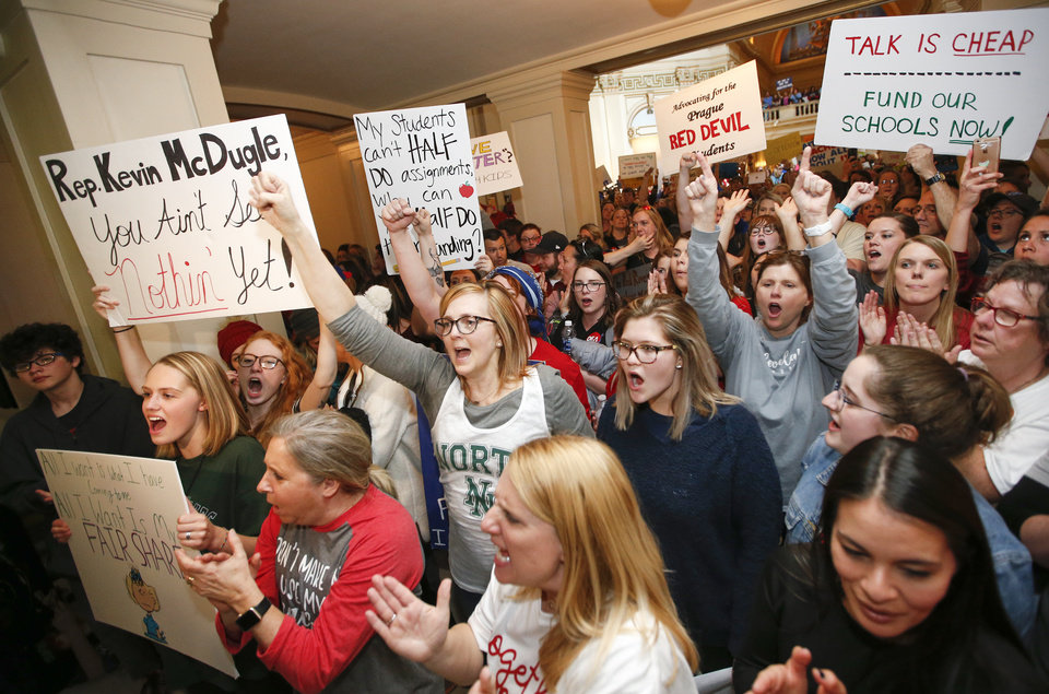 Photo -  Teachers, students and supporters of increased education rally outside the entrance to the chamber of the House of Representatives on the fourth floor of the state Capitol during the third day of a walkout by Oklahoma teachers. [Photo by Nate Billings, The Oklahoman]