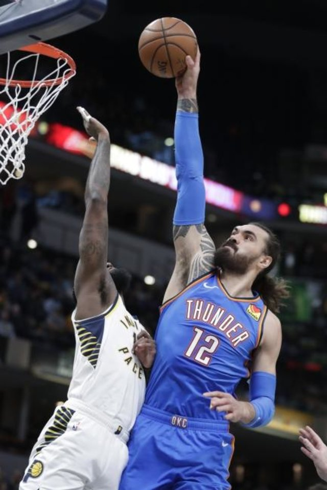 Photo -  Oklahoma City Thunder center Steven Adams misses a dunk over Indiana Pacers forward JaKarr Sampson during Tuesday night's game in Indianapolis. The Pacers whipped Oklahoma City, 111-85. [AP Photo/Michael Conroy]