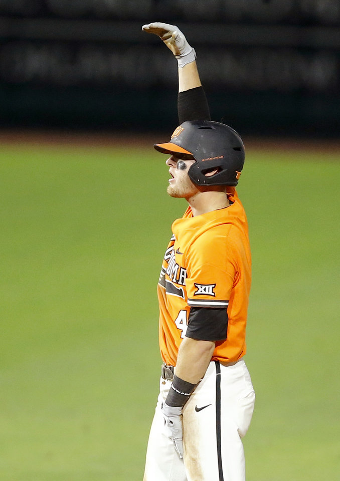 Photo - Oklahoma State's Andrew Navigato (4) celebrates after driving a run in on a double in the sixth inning of a Big 12 baseball tournament game between Oklahoma State University (OSU) and TCU at Chickasaw Bricktown Ballpark in Oklahoma City, Okla., Wednesday, May 22, 2019.  [Bryan Terry/The Oklahoman]