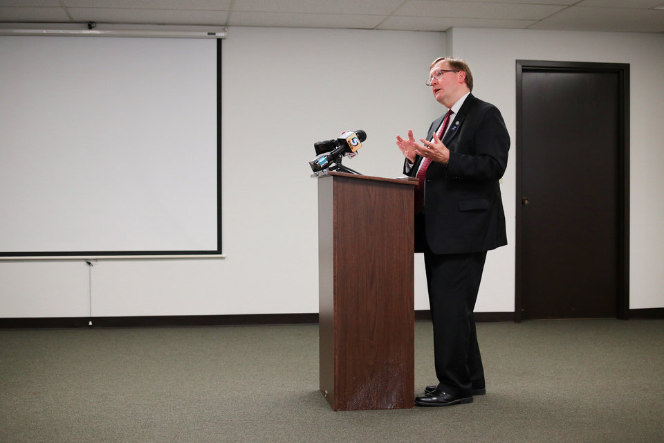 Photo -  Brian Hermanson, chairman of the Oklahoma District Attorneys Council, speaks during a news conference Tuesday. [Photo by Doug Hoke, The Oklahoman]
