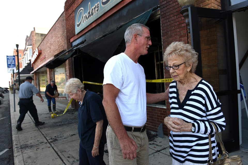 Photo -  Dena Ander, 103, right, outside of her shoe store in Miami that she has ran for 85 years and was destroyed by a suspicious fire early Tuesday morning. [Photo by GARY CROW, For the Oklahoman]