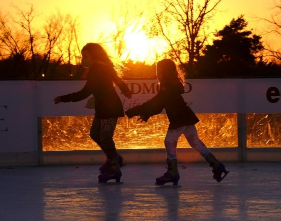 Photo -  People skate at the ice rink at Mitch Park in Edmond. [Doug Hoke/The Oklahoman]