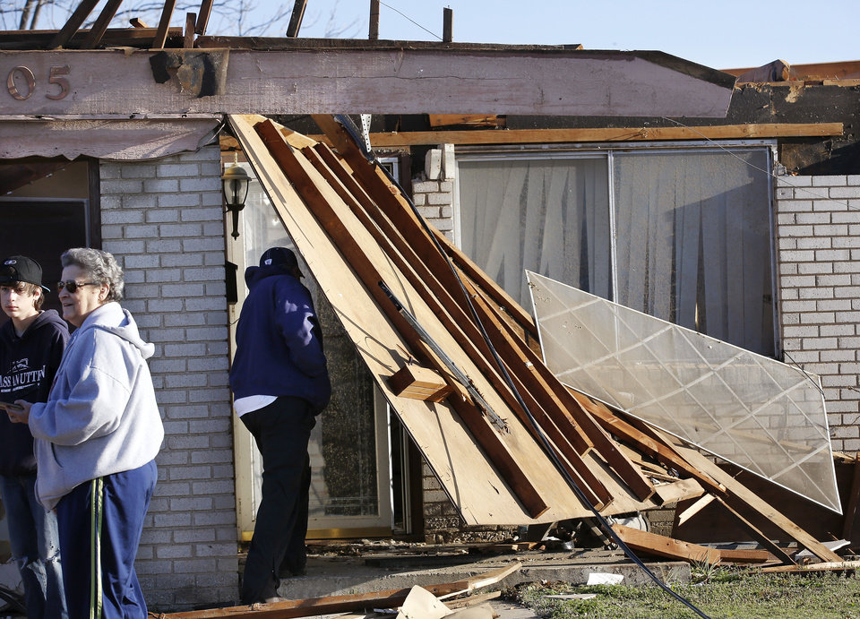 Photo - Joetta Strain's home, in the 900 block of NW 2 in Moore. Neighborhood  between NW 5 and Main Street, and between Telephone Rd. and Santa Fe in Moore.  Thursday morning, March 26, 2015, the day after a tornado damaged homes and a school Wednesday evening. Photo by Jim Beckel, The Oklahoman