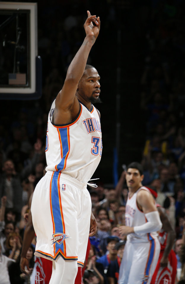 Photo - Oklahoma City's Kevin Durant (35) points after a basket during an NBA basketball game between the Oklahoma City Thunder and the Houston Rockets at Chesapeake Energy Arena in Oklahoma City, Friday, Jan. 29, 2016. Oklahoma City won 116-108. Photo by Bryan Terry, The Oklahoman