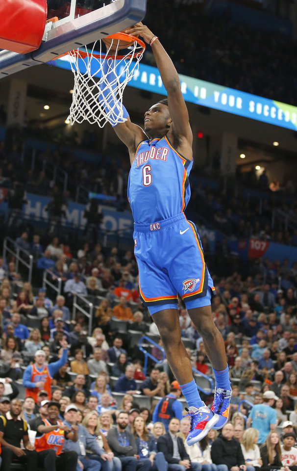Photo - Oklahoma City's Hamidou Diallo (6) goes up for a dunk during the NBA game between the Oklahoma City Thunder and the Golden State Warriors at Chesapeake Energy Arena,   Saturday, Nov. 9, 2019.  [Sarah Phipps/The Oklahoman]