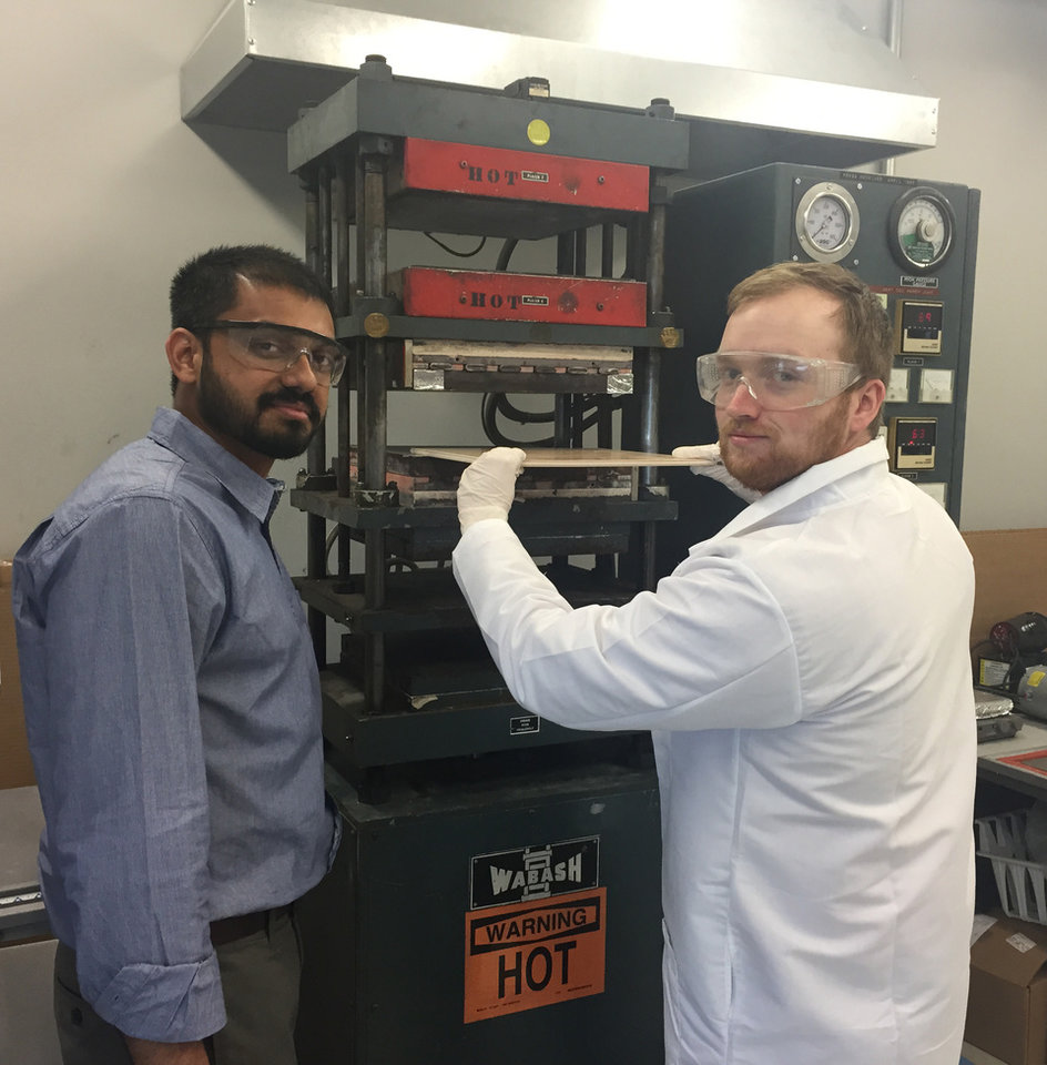 Photo - Dr. Balaji Jayakumar, Research Scientist, and Richard Paige, Research Technician, fabricate composite panels.
