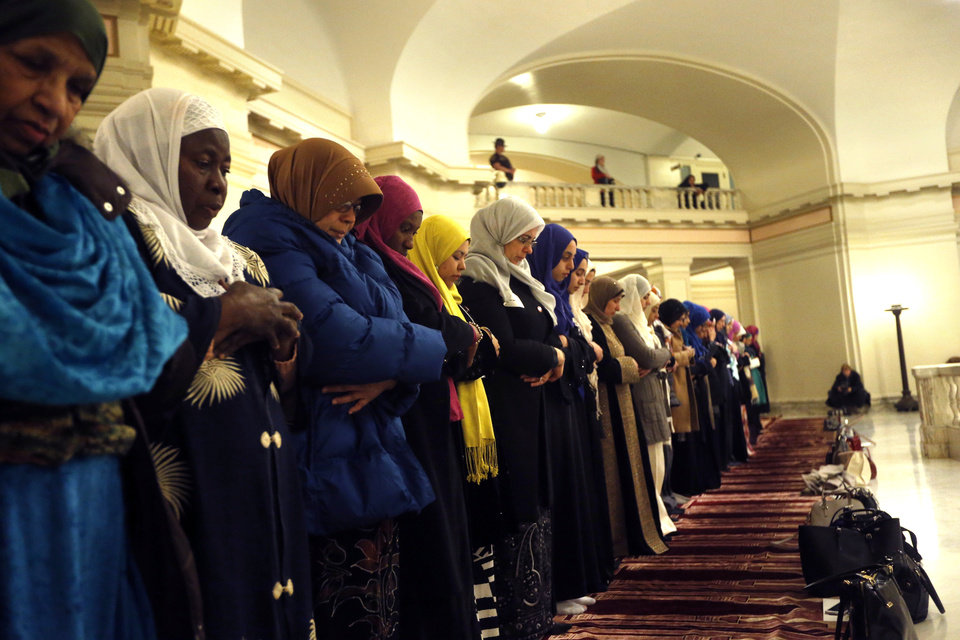 Photo - Women pray during Oklahoma Muslim Day at the state Capitol in Oklahoma City Friday, Feb. 27, 2015. Photo by Sarah Phipps, The Oklahoman