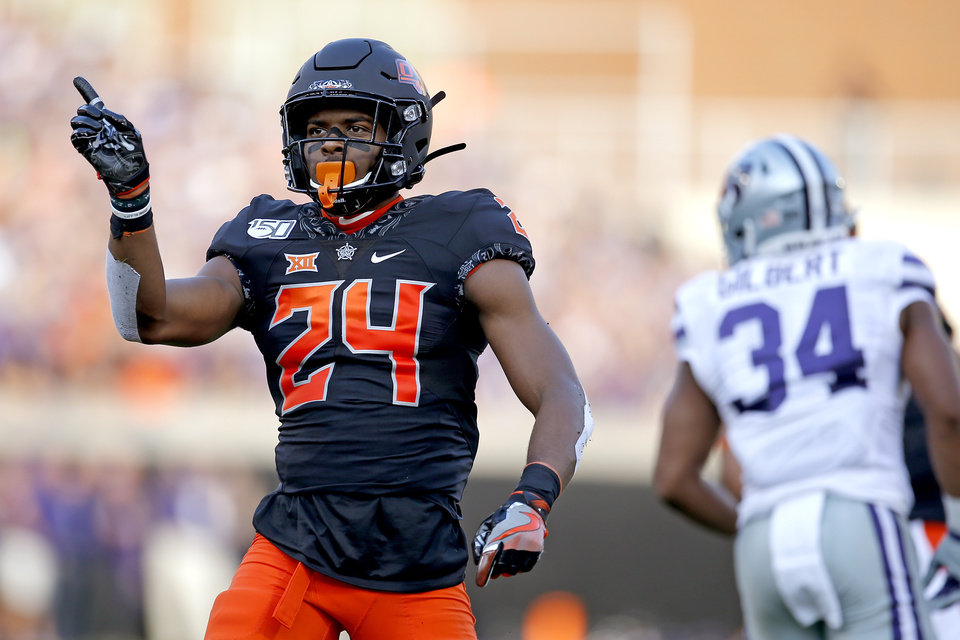 Photo - Oklahoma State's Jarrick Bernard (24) celebrates a defensive play in the first quarter during the college football game between the Oklahoma State Cowboys and the Kansas State Wildcats at Boone Pickens Stadium in Stillwater, Okla., Friday, Sept. 27, 2019. [Sarah Phipps/The Oklahoman]