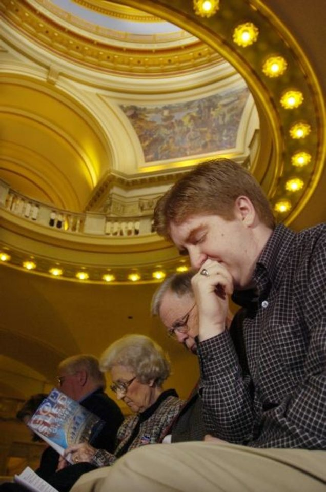 Photo -  In this 2005 photo, Michael Ware prays during a National Day of Prayer service at the State Capitol. [Oklahoman Archives]