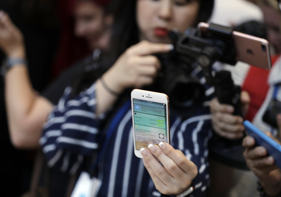 Photo - The new iPhone 8 Plus is displayed in the showroom after the new product announcement at the Steve Jobs Theater on the new Apple campus on Tuesday, Sept. 12, 2017, in Cupertino, Calif. (AP Photo/Marcio Jose Sanchez)