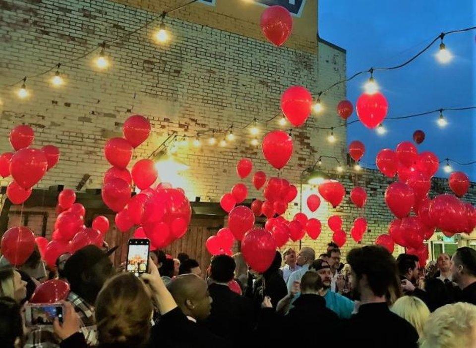 Photo -  Red Balloons were released during a memorial service for chef Chad Epley in April. [Dave Cathey/The Oklahoman]