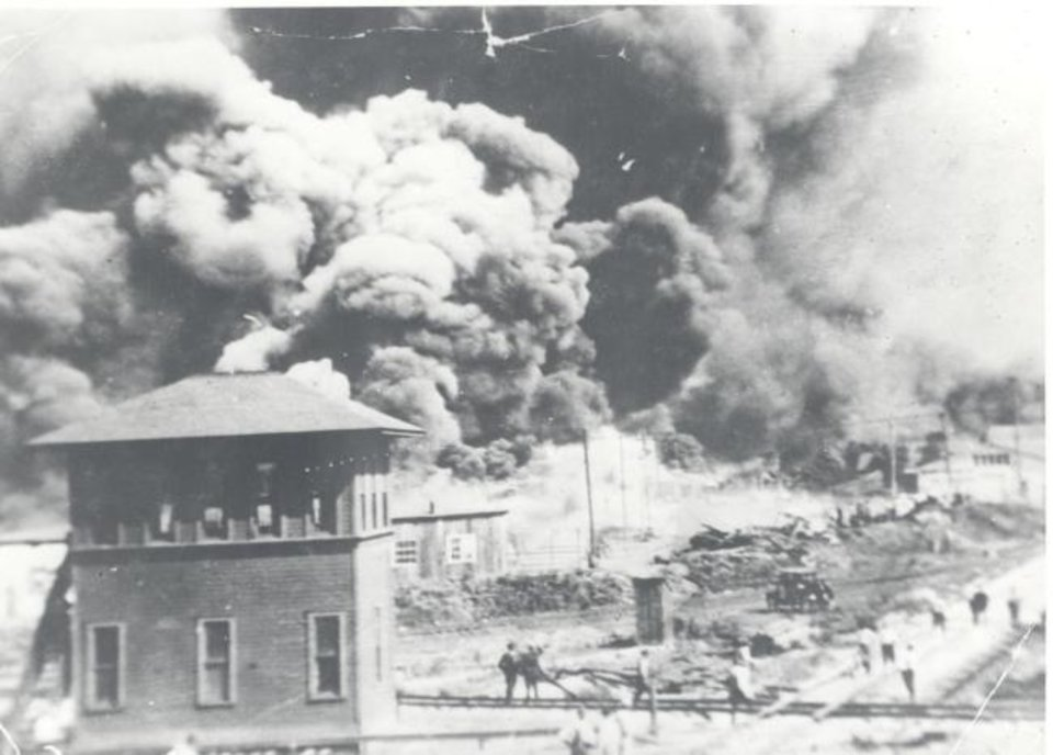 Photo -  Portions of Tulsa's Greenwood District burn during the 1921 race riot. [PROVIDED BY THE OKLAHOMA HISTORICAL SOCIETY]