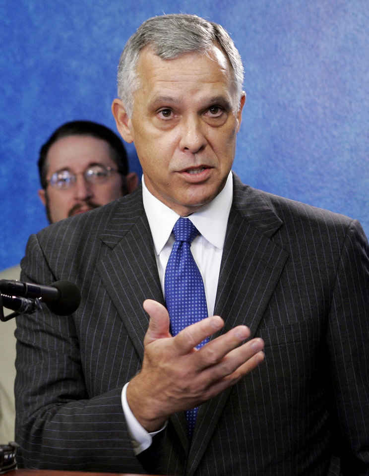 Photo - FILE - In this Aug. 24, 2006 file photo, Kirk Humphreys, the former mayor of Oklahoma City, speaks at a news conference in Oklahoma City. Humphreys, a member of the University of Oklahoma Board of Regents, is being criticized Monday, Dec. 11, 2017, for comparing gay people to pedophiles and politicians who have resigned recently after allegations of sexual misconduct. Humphreys made the comments over the weekend on a television public affairs show. The LGBTQ advocacy group Freedom Oklahoma has called for his removal from the board if he does not apologize. (AP Photo/File)