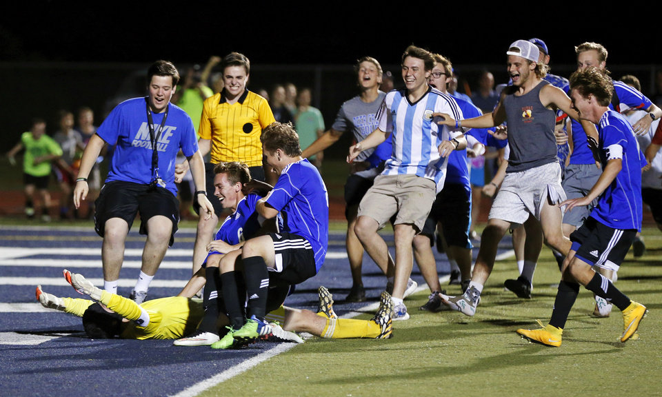 Deer Creek Players And Fans Rush To Goalkeeper Austen Parker 1 On Ground
