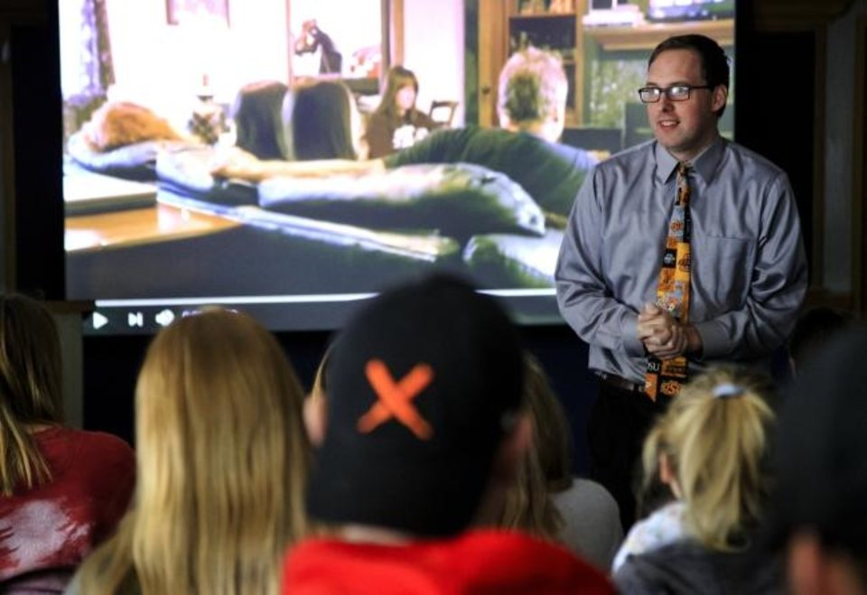 Photo -  Multimedia Journalism Professor Shane Hoffman talks to students as he teaches a class at Oklahoma State University in Stillwater. [Chris Landsberger photos/The Oklahoman]