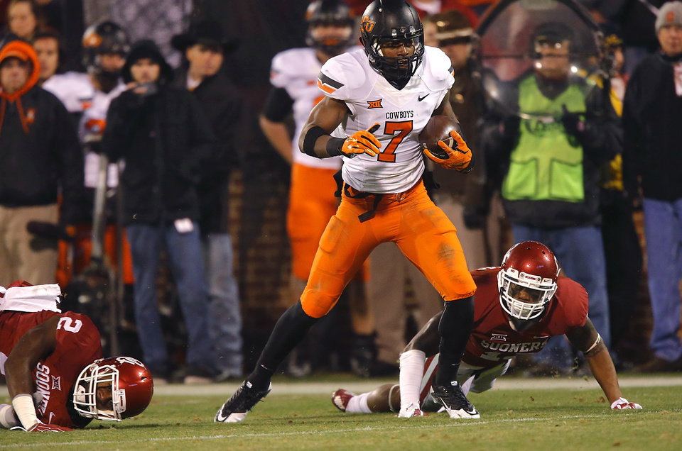 Photo - Oklahoma's Julian Wilson (2) and Ahmad Thomas (13) hit the turf as Oklahoma State's Brandon Sheperd (7) makes a catch for a touchdown during a Bedlam college football game between the University of Oklahoma Sooners (OU) and the Oklahoma State University Cowboys (OSU) at the Gaylord Family Oklahoma Memorial Stadium in Norman, Okla. on Saturday, Dec. 6, 2014. Photo by Chris Landsberger, The Oklahoman
