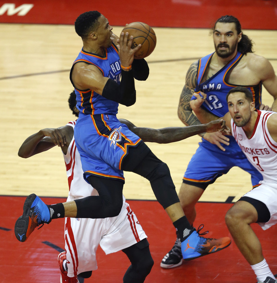 Photo - Oklahoma City's Russell Westbrook (0) leaps past Houston's Patrick Beverley (2) as /o12n/ and Houston's Ryan Anderson (3) watch during Game 2 in the first round of the NBA basketball playoffs between the Oklahoma City Thunder and the Houston Rockets at the Toyota Center in Houston, Texas,  Wednesday, April 19, 2017.  Photo by Sarah Phipps, The Oklahoman