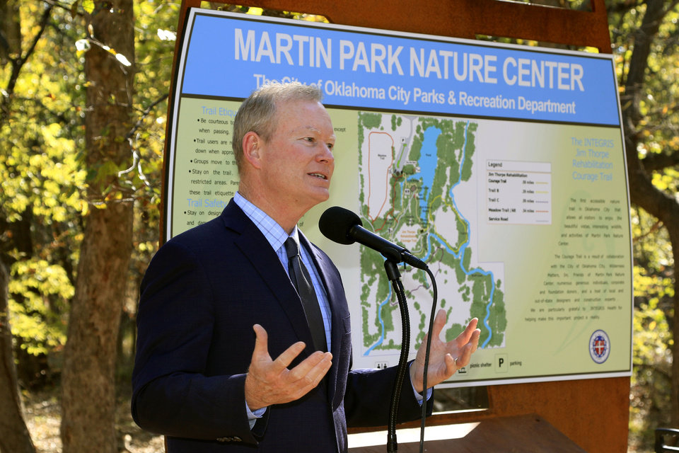 Photo - OKC Mayor Mick Cornett speaks during the dedication of the new accessible trail at Martin Park Nature Center in Oklahoma City, OK, Tuesday, November 3, 2015,  Photo by Paul Hellstern, The Oklahoman