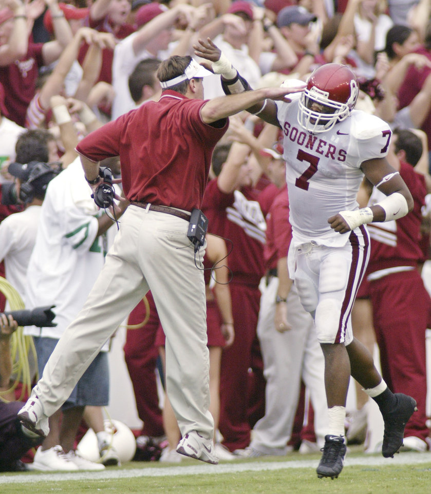 Photo - University of Oklahoma vs Texas college football at the Cotton Bowl in Dallas, TX. October 11, 2003. OU head coach Bob Stoops celebrates with Brandon Everage. Staff photo by Doug Hoke.