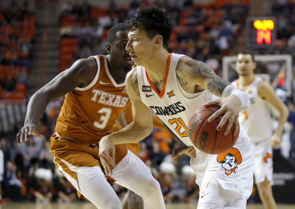 Photo - Oklahoma State's Lindy Waters III (21) goes past Texas' Courtney Ramey (3) during an NCAA basketball game between the Oklahoma State University Cowboys (OSU) and the Texas Longhorns at Gallagher-Iba Arena in Stillwater, Okla., Wednesday, Jan. 15, 2020. [Bryan Terry/The Oklahoman]