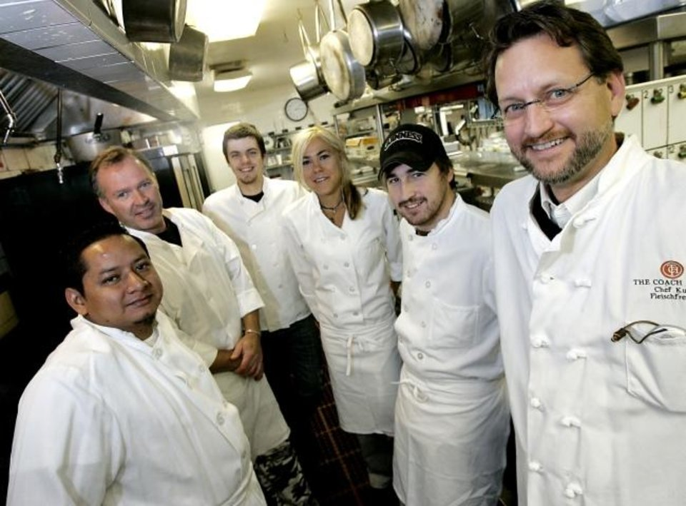 Photo -  Chef Kurt Fleischfresser, right, is seen in 2007 with his Coach House apprentices, from left, Rolyn Soberanis, Keith Zinke, Kevin Ward, Mackenzie Bentley and Josh Valentine  at the Coach House restaurant's kitchen in Oklahoma City. [Oklahoman Archive photo]