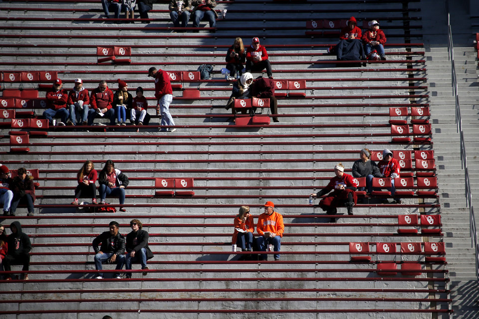 Photo - Fans wait for the start of a Bedlam college football game between the University of Oklahoma Sooners (OU) and the Oklahoma State University Cowboys (OSU) at Gaylord Family-Oklahoma Memorial Stadium in Norman, Okla., Nov. 10, 2018.  Photo by Bryan Terry, The Oklahoman