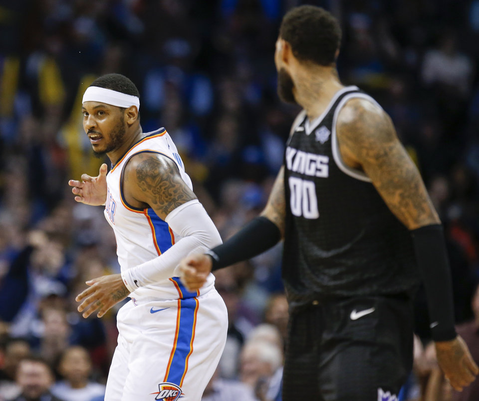 Photo - Oklahoma City's Carmelo Anthony (7) reacts after making a 3-point shot near Sacramento's Willie Cauley-Stein (00) during an NBA basketball game between the Oklahoma City Thunder and the Sacramento Kings at Chesapeake Energy Arena in Oklahoma City, Monday, March 12, 2018. Oklahoma City won 106-101. Photo by Nate Billings, The Oklahoman