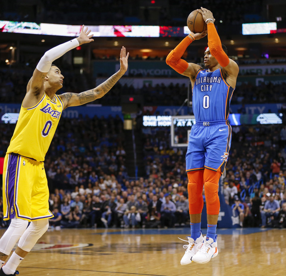 Photo - Oklahoma City's Russell Westbrook (0) shoots near Los Angeles' Kyle Kuzma (0) during an NBA basketball game between the Los Angeles Lakers and the Oklahoma City Thunder at Chesapeake Energy Arena in Oklahoma City, Thursday, Jan. 17, 2019. Photo by Nate Billings, The Oklahoman