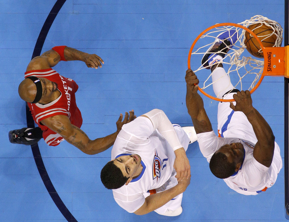 Photo - Oklahoma City's Dion Waiters (3) dunks in front of Enes Kanter (11) and Houston's Jason Terry (31) during an NBA basketball game between the Oklahoma City Thunder and the Houston Rockets at Chesapeake Energy Arena in Oklahoma City, Tuesday, March 22, 2016. Oklahoma City won 111-107. Photo by Bryan Terry, The Oklahoman