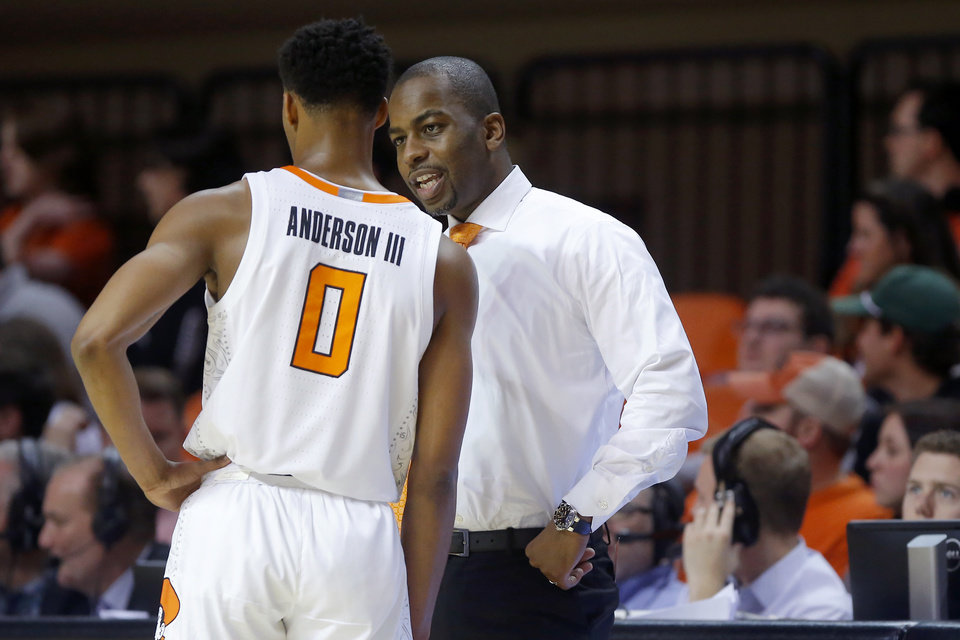 Photo - Oklahoma State coach Mike Boynton talks with Oklahoma State's Avery Anderson III (0) during an NCAA basketball game between the Oklahoma State University Cowboys (OSU) and the Texas Longhorns at Gallagher-Iba Arena in Stillwater, Okla., Wednesday, Jan. 15, 2020. Oklahoma State lost 76-64. [Bryan Terry/The Oklahoman]