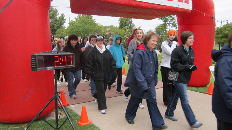 Photo - Participants in last year's Heels for Hope one-mile walk cross the finish line. Photo provided