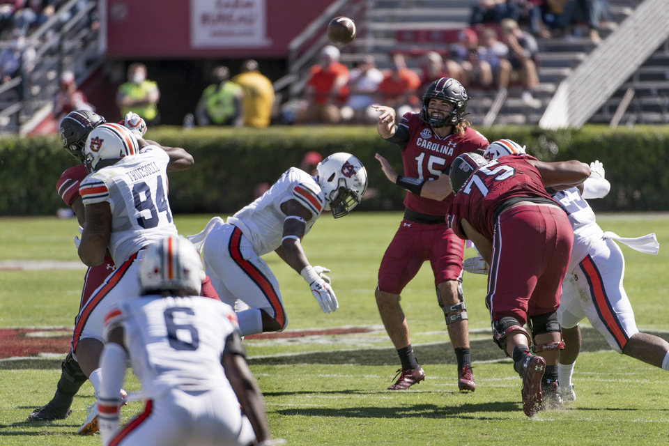 Photo -  South Carolina quarterback Collin Hill (15) attempts a pass during the first half against Auburn. [Sean Rayford/the associated press]
