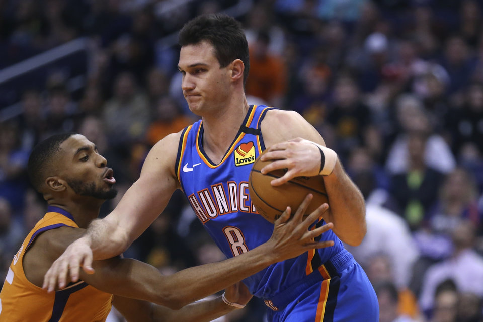 Photo - Oklahoma City Thunder forward Danilo Gallinari (8) gets fouled by Phoenix Suns forward Mikal Bridges, left, during the second half of an NBA basketball game Friday, Jan. 31, 2020, in Phoenix. The Thunder defeated the Suns 111-107. (AP Photo/Ross D. Franklin)