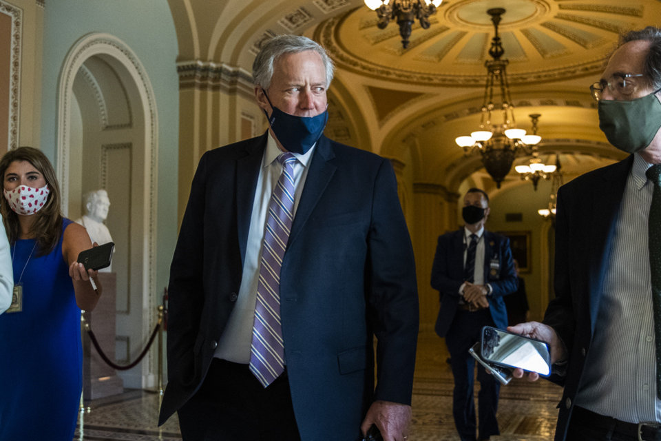 Photo -  White House chief of staff Mark Meadows speaks to reporters Thursday at the Capitol in Washington. [Manuel Balce Ceneta/The Associated Press]