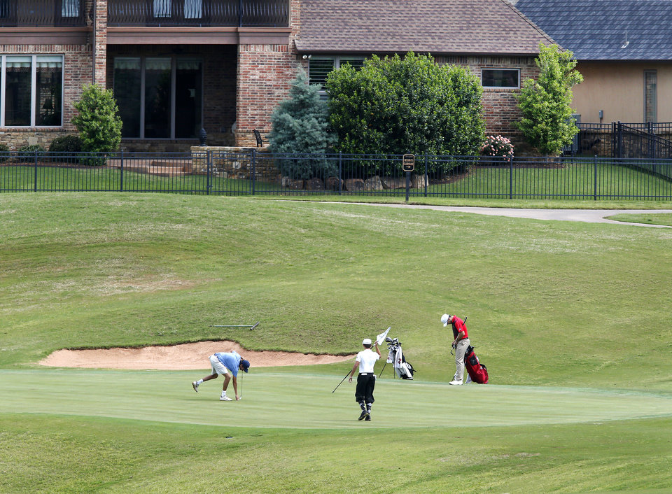 Photo - Golfers on a green during Class 6A boys golf state tournament at Rose Creek golf course on Monday, May 6, 2019.  [Jim Beckel/The Oklahoman]