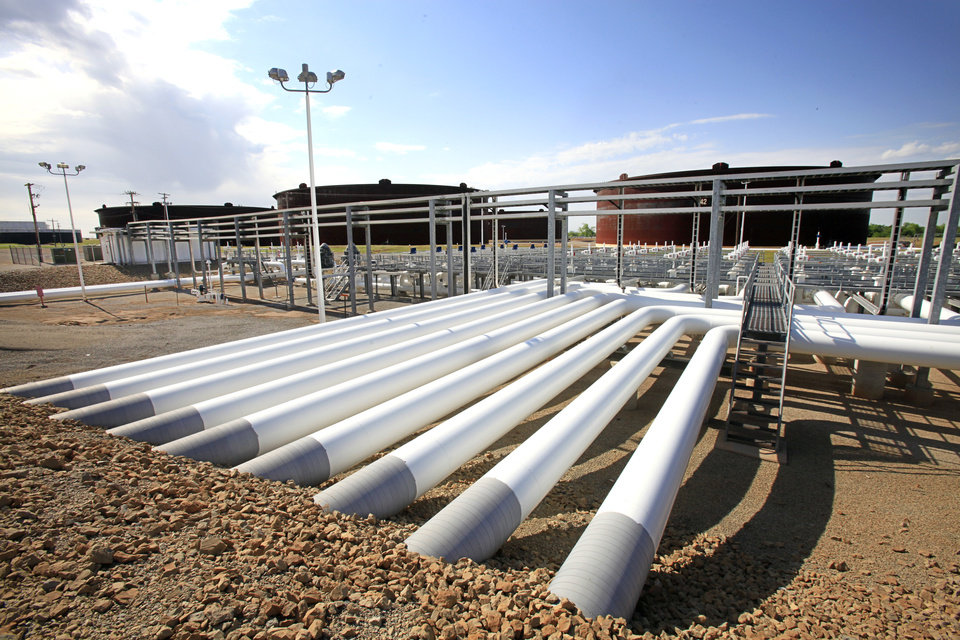 Photo -  Technology has created new markets for traditional energy sources like oil. This photo shows oil tanks and pipelines in Cushing, the nation's largest commercial oil hub. [THE OKLAHOMAN ARCHIVES]