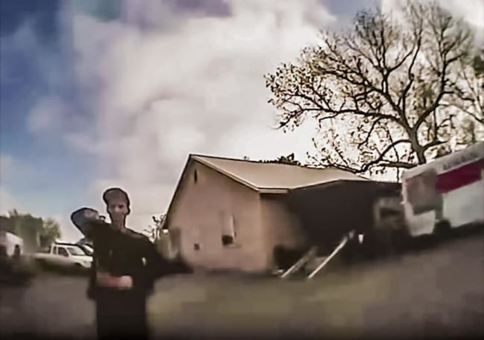 Photo -  In this screen grab from a bodycam video, Nathan LeForce fires at Logan County Sheriff's Deputy David Wade on April 18, 2017.