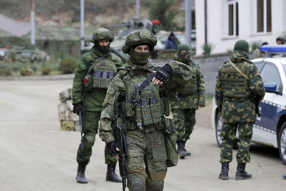 Photo -  Russian peacekeepers patrol an aria in Stepanakert, the separatist region of Nagorno-Karabakh, on Sunday, Nov. 15, 2020. Ethnic Armenian forces had controlled Nagorno-Karabakh and sizeable adjacent territories since the 1994 end of a separatist war. Fighting resumed in late September and have now ended with an agreement that calls for Azerbaijan to regain control of the outlying territories as well as allowing it to hold on to parts of Nagorno-Karabakh that it seized during the fighting. (AP Photo/Sergei Grits)