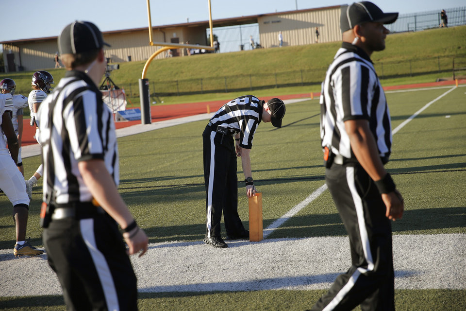 04f038d37 Officials Jason DeBerry checks the pylon before officiating a high school  football game in Moore