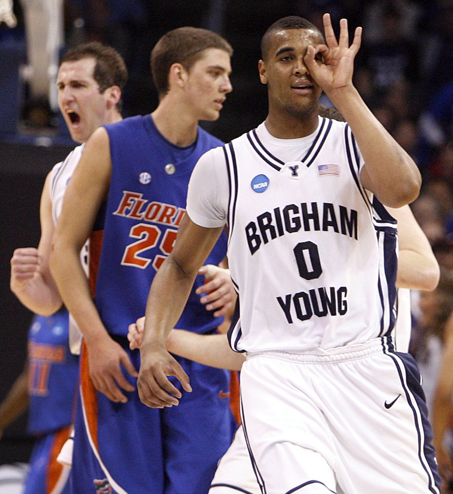 Photo -  BYU's Brandon Davies (0) reacts after Jimmer Fredette hit a three point shot in the second over time during the NCAA Men's first round basketball tournament game between the University of Florida and BYU at the Ford Center on Thursday, March 18, 2010, in Oklahoma City, Okla.  Photo by Chris Landsberger, The Oklahoman ORG XMIT: KOD