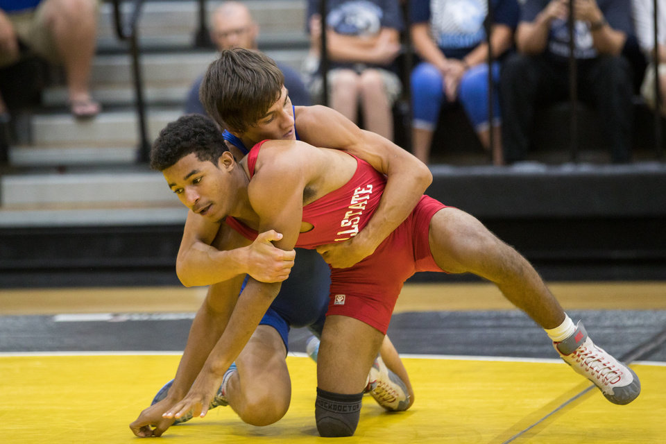Photo - Carl Albert's Jayston Cato (front) wrestles Bartlesville's Laif Jones during the Wrestling All State games at the Dubie Fieldhouse in Sand Springs, OK on 7/24/19.  BRETT ROJO/For the Tulsa World