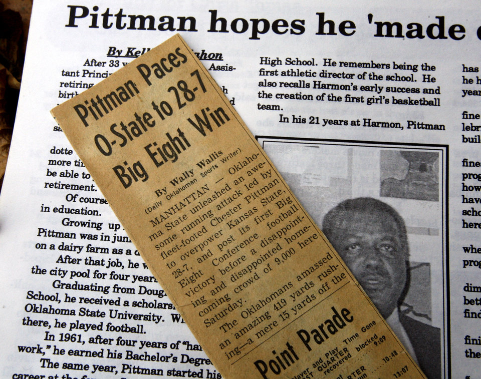Photo - NEWSPAPER CLIPPING / FORMER OKLAHOMA STATE UNIVERSITY (OSU) COLLEGE FOOTBALL PLAYER: Chester Pittman's press clippings are shown at his home on Friday, November 6, 2009, in Kansas City, Kansas.  He became the first black man to earn a football letter exactly 50 years ago this season.  Photo by Steve Sisney, The Oklahoman ORG XMIT: KOD