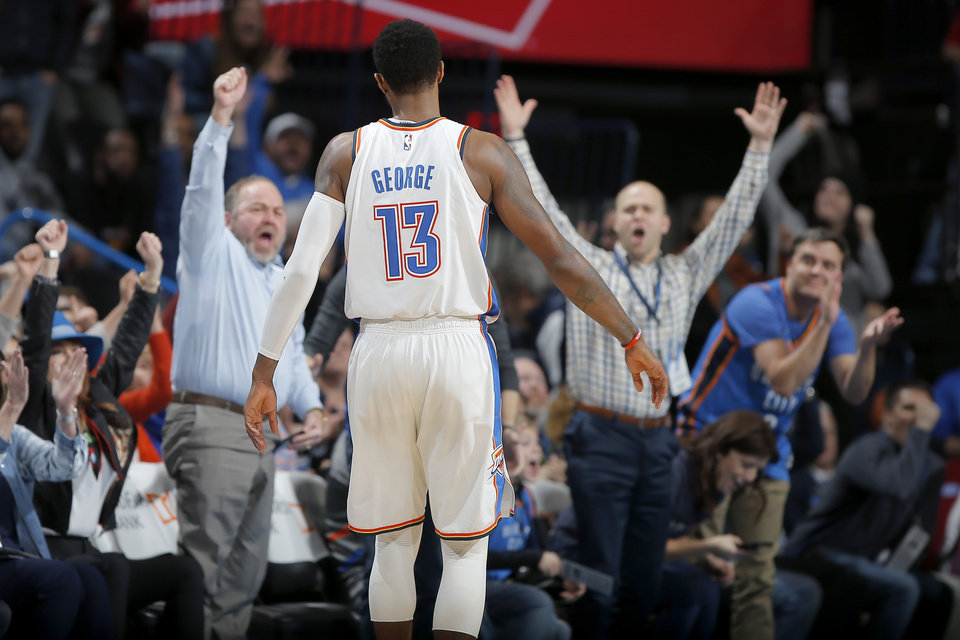 Photo - Fans celebrate after Oklahoma City's Paul George (13) made a 3-pointer during an NBA basketball game between the Oklahoma City Thunder and the New Orleans Pelicans at Chesapeake Energy Arena in Oklahoma City, Thursday, Jan. 24, 2019. Photo by Bryan Terry, The Oklahoman
